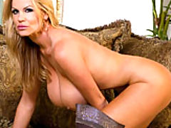 Huge Tits, Kelly teases you in a teal dress then rubs on her pussy while wearing super sexy thigh high boots.