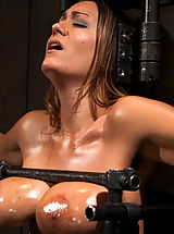 nice titts, Trina Michaels takes the fuck machine hard and fast. She is gagged, blindfolded, whipped, caned and fingered into orgasm after orgasm.