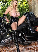 Huge.Tits Pics: Blonde babe Sapphire soloing in latex on motorbike outdoors