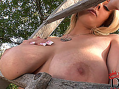 Huge.Tits Vids: Busty blonde babe Sapphire posing her shaved pussy outdoors