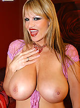 Huge.Tits Pics: Kelly is wearing red lingerie and masturbates with pink dildo.