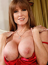 Naughty America Pics: Hot mom Darla Crane is horny and ready to suck and fuck two big cocks at the same time in this threesome.