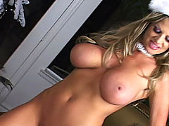 Busty Lesbian, Kelly gets fucked and bounces her tits under the X-Mas tree.
