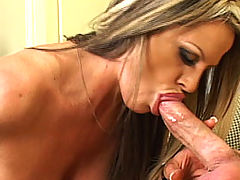 Asian Busty Movies, Kelly Madison gets fucked on a couch in her poka dot dress.