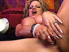Mature Busty Movies, Psychic Kelly is having an orgasm and sucking her pussy juice off her dildo.