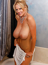 Bigtits Officesex, Kelly hops in the bath and her white dress turns see thru.