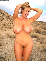 Sexy Busty, Kelly wears a little black dress and gives a blowjob in the desert.
