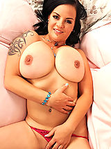 Hot busty Mandy May poses her tattooed & pierced sexy body