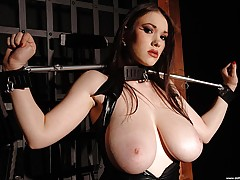 Babes Vids: Busty babe Anna Song tied up, in and out of tight latex